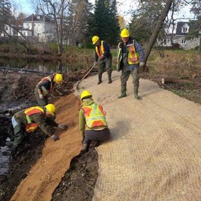 Rolling out the matting to stabilize the new shoreline