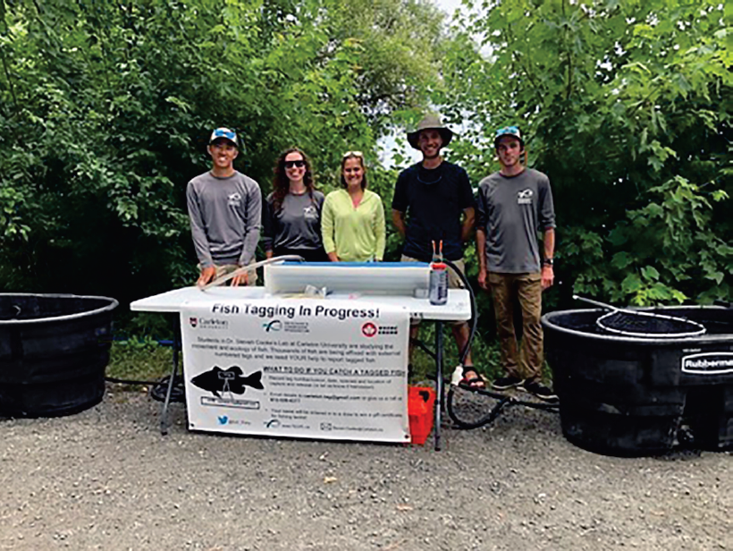 Figure 3: Dr. Cooke's students ready to externally tag incoming bass at a Bass Anglers Association tournament. LR: Auston Chhor, Alexandria Trahan, Brenna Gagliardi.